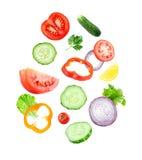 Falling fresh vegetable slices. On white background Stock Photo