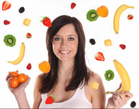Falling fruits with beautiful brunette woman Stock Photos