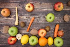 Falling fruits and vegetables on wooden background.  royalty free stock photography