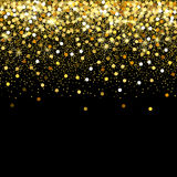 Falling golden particles on a black background. Scattered golden confetti. Rich luxury fashion backdrop. Bright shining. Falling golden particles on a black Royalty Free Stock Photo