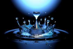 Falling heart shaped water drop into the water Stock Photos