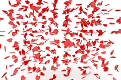 Falling Hearts. A number of red hearts falling from the top of the image set against a white background Stock Photo