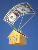 Falling Home Prices. A golden house falling from the sky with a dollar bill parachute, against a blue sky. Symbol of falling home prices, investment risk, or a Stock Images