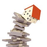 Falling house. House falling from pile of dollars Royalty Free Stock Photos