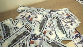 Falling hundred dollars banknotes stock footage