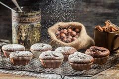 Falling icing sugar on fresh chocolate muffins Royalty Free Stock Photo