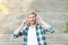 Free Falling In Love With My Headphones. Happy Guy Wear Headphones Outdoors. Handsome Man Listen To Music In Headphones. New Royalty Free Stock Photos - 190992188