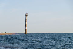 Falling Kiipsaare lighthouse in water of Baltic sea Stock Image