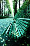 Falling leaves. Autumn in city Park in yellow leaves. Yellow maple leaves on garden bench, sad mood of past summer royalty free stock photo