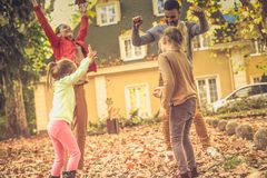 Falling leaves and my family. royalty free stock images