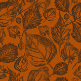 Falling leaves on an orange background, seamless pattern Stock Photo