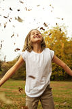 Falling leaves on Smiling girl Stock Photos