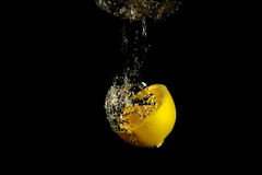 Falling lemon into water Royalty Free Stock Photography