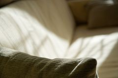 Falling light and shadow on sofa, bedroom background royalty free stock images