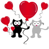 Falling love cats with hearts balloon on white background Stock Images