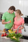 Falling in love in the kitchen. Falling in love during preparing a dinner royalty free stock images
