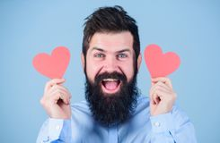 Falling in love. Man bearded hipster with heart valentine card. Celebrate love. Guy attractive with beard and mustache. In romantic mood. Feeling love. Dating royalty free stock image