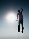 Falling man. Man fly in air. Man falling down with hands up. stock photos