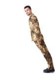 Falling man in military uniform Stock Image