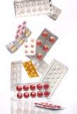 Falling medicine pills blister packs Royalty Free Stock Photography
