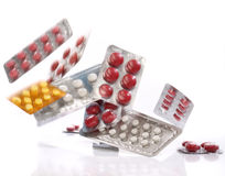 Falling medicine pills blister packs Stock Photo