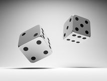 Falling metal dices Stock Photos