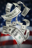 Falling Money $100 Bills. Against American flag Royalty Free Stock Image