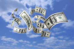 Falling Money $100 Bills. Photo of Falling Money $100 Bills in the sky Royalty Free Stock Photos