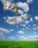 Falling Money $100 Bills. And a blue sky Royalty Free Stock Photography