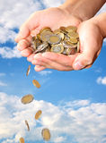 Falling money. Falling coins from man hands stock photography