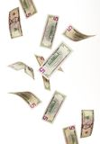 Falling money. Isolated on white Royalty Free Stock Photo