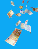 Falling money. Euro notes in various denominations fall from the sky royalty free stock photos