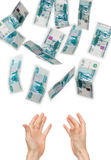 Falling money. For a white background Royalty Free Stock Images