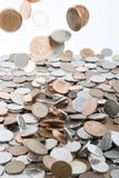 Falling Money. British coins falling on to a pile Royalty Free Stock Photo