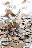 Falling Money. British coins falling onto a pile Stock Images