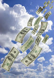 Falling money. Money Falling from Blue Sky royalty free stock image