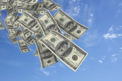 Falling money blue sky Stock Photos