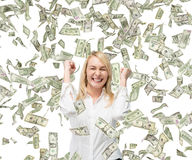 Falling money. Happy beautiful businesswoman and falling money Stock Photo
