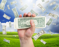 Falling money on landscape. Success theme Royalty Free Stock Photos