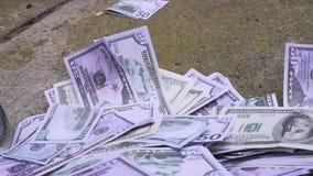 Falling money on sidewalk stock footage