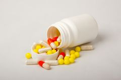 Falling multi-colored pills Royalty Free Stock Photos