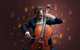 Falling notes with classical musician. Young cellist with falling musical notes wallpaper and classical concept royalty free stock photography