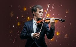Falling notes with classical musician royalty free stock photos