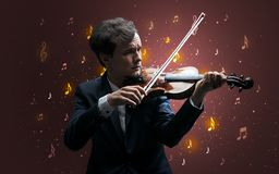 Falling notes with classical musician royalty free stock image