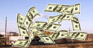 Falling notes of US dollar against industrial plant Royalty Free Stock Image