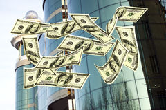 Falling notes of US dollar against Office building Stock Photography