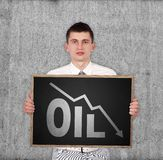 Falling oil chart Royalty Free Stock Photos