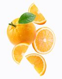Falling orange and orange slices Royalty Free Stock Image