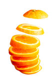Falling orange slices Royalty Free Stock Images