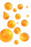 Falling oranges. With simulated depth of field Royalty Free Stock Photography